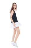 Young fashion girl in white skirt posing isolated Royalty Free Stock Image
