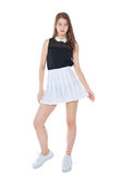 Young fashion girl in white skirt posing isolated Stock Photos