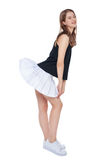 Young fashion girl in white skirt posing isolated royalty free stock photos