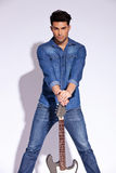 Young fashion guitarist Royalty Free Stock Photography