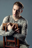 Young, fashion, handsome, caucasian, man sitting in the  chair Stock Image