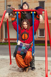 Young fashion hippie couple on the swing Royalty Free Stock Photo