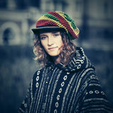 Young fashion hippie woman walking outdoor. Young fashion hippie woman in rasta hat walking outdoor Royalty Free Stock Photos