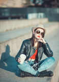 Young fashion hipster beautiful girl in leather jacke with retro Royalty Free Stock Photo