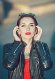 Young fashion hipster beautiful girl in leather jacket in the ci Stock Photo