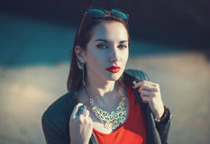 Young fashion hipster beautiful girl in leather jacket in the ci Royalty Free Stock Image
