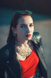 Young fashion hipster beautiful girl in leather jacket in the ci Royalty Free Stock Photography