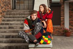 Young fashion hipster couple on the steps Stock Photos