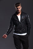 Young fashion male model in leather jacket posing Stock Photos