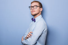Young fashion male model wearing bow tie and blue shirt Stock Photo