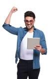 Young fashion man celebrating a success Stock Photos