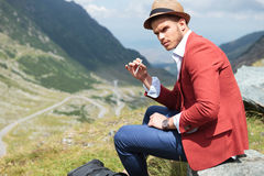 Young fashion man with cigarette outdoor Royalty Free Stock Photography