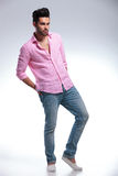 Young fashion man with hands in rear pockets Royalty Free Stock Image