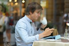 Young fashion man / hipster drinking espresso coffee in the city cafe Royalty Free Stock Photos