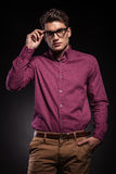Young fashion man holding his hand in pocket Royalty Free Stock Photos