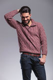 Young fashion man holding his thumb in his pocket Royalty Free Stock Photos