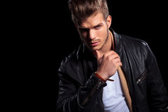 Young fashion man in leather jacket thinking stock image