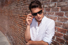 Young fashion man looking down Royalty Free Stock Images