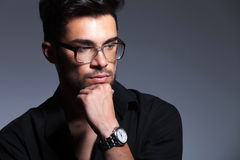 Young fashion man looking pensively away Stock Photo