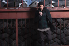 Young fashion man near many tires Royalty Free Stock Photography