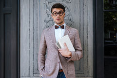 Young fashion man with nerd glasses and stylish hairdo posing Royalty Free Stock Photos
