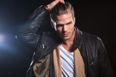 Young fashion man passing his hand through his hair Royalty Free Stock Photos