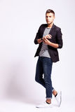 Young fashion man in a pose Royalty Free Stock Images