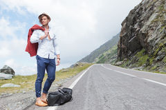 Young fashion man posing on road side Royalty Free Stock Photos