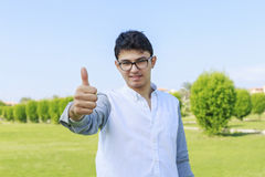 Young fashion man showing thumb up.Great like. Royalty Free Stock Images