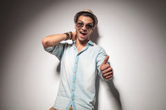 Young fashion man showing the thumbs up gesture Stock Photos