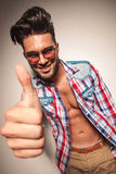 Young fashion man showing the thumbs up gesture. Royalty Free Stock Images