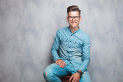 Young fashion man sitting on a chair Royalty Free Stock Photos