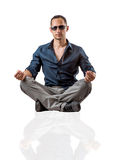 Young fashion man sitting on white background Royalty Free Stock Photography