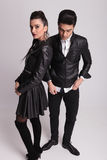 Young fashion man standing beside his girlfriend Stock Image