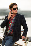 Young fashion man in sunglasses calling on phone Stock Image