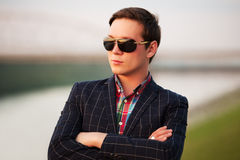 Young fashion man in sunglasses at sunset Royalty Free Stock Photos