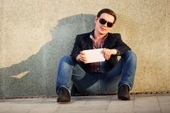 Young fashion man with tablet computer Stock Photo