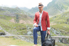 Young fashion man with voyage bag outdoor Royalty Free Stock Images