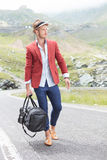 Young fashion man walks on the road stock photo