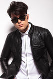 Young fashion man wearing a black leather jacket Royalty Free Stock Photography