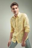 Young fashion man wearing a yellow shir Stock Photos