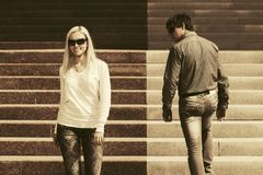 Young fashion man and woman flirting on city street royalty free stock images