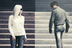 Young fashion man and woman flirting in a city street royalty free stock photos
