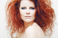 Young fashion model with curly red hair. Stock Photo