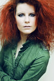 Young fashion model with curly red hair. Stock Photography