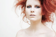 Young fashion model with curly red hair. Stock Photos