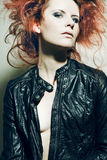 Young fashion model with curly red hair. Stock Image