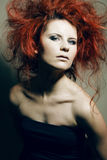 Young fashion model with curly red hair. Royalty Free Stock Photos