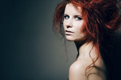 Young fashion model with curly red hair. Royalty Free Stock Images