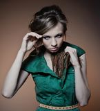 A young fashion model with a steadfast gaze Royalty Free Stock Images